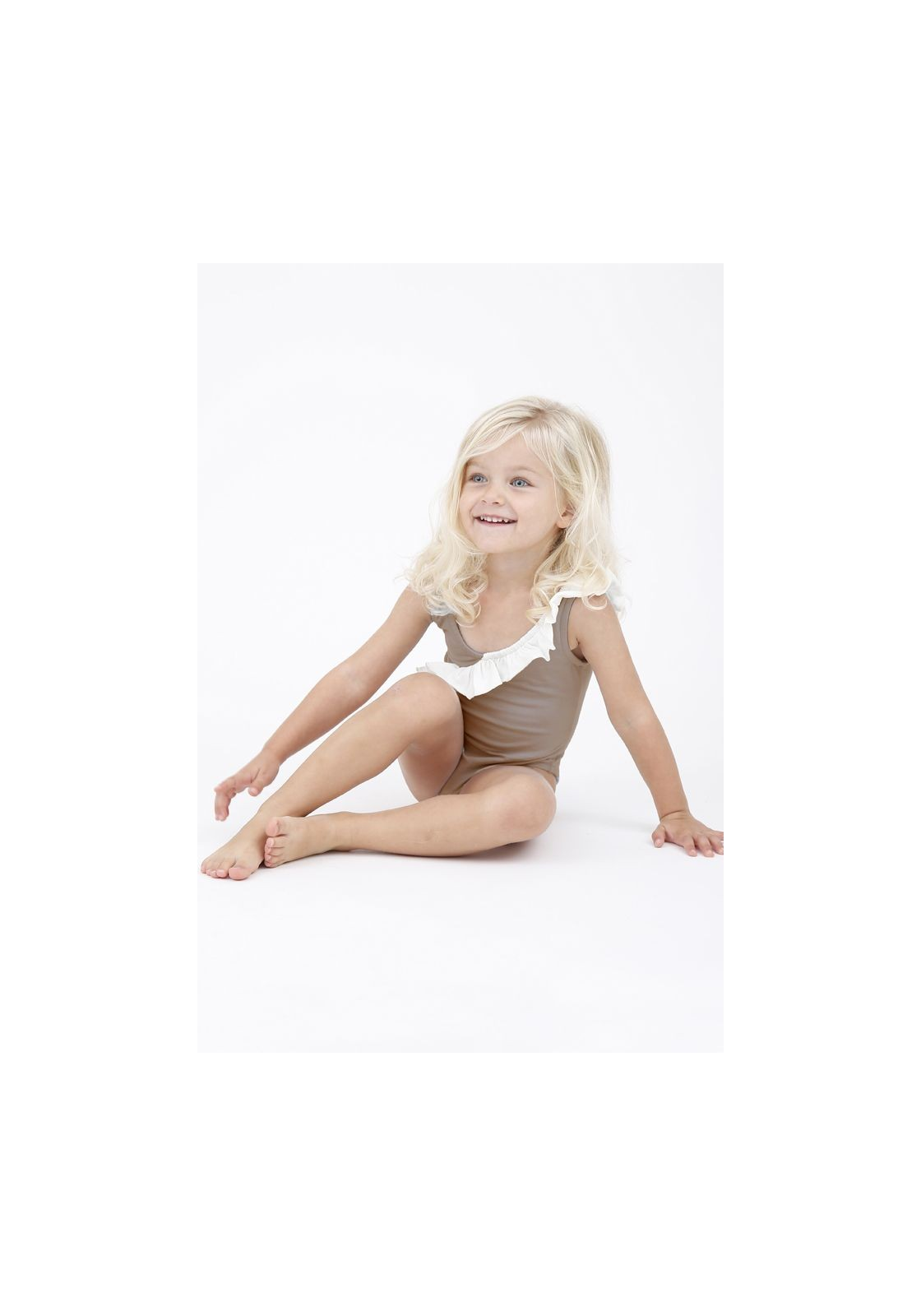c7cbbb36423fe One piece swimsuit for children in beige and white with ruffles